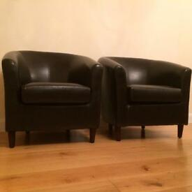 Two matching leather tub chairs as New