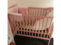 Small pink cot