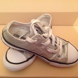 Girly converse in silver sparkles.
