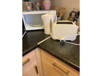 Three set of white microwave kettle and toaster
