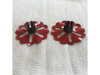 2 (a pair) vintage red metal flower shape candle holders. Happy to post. £2 both.
