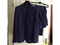 "Moss bros blue suit,worn once. Jacket 40"", trousers 32 l"