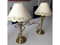 two bedside lamps with gold stand and cream shades £15