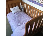 Wooden Boori cot bed with mattress.