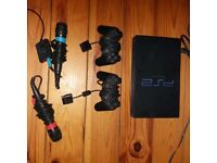 Playstation 2, 2 controllers, 2 mics, approx 50 games