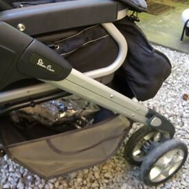 Black and silver Silver Cross travel system pram with accessories