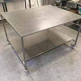 Large stainless steel table with under-storage (great for commercial kitchens)