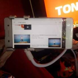sony experia xa white forgotten recovery email n crack along top of the phone just under sony tag