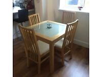 Dining table and 4 chairs - all in good condition