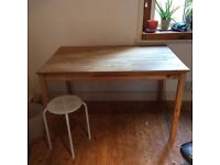 Small wooden dining table (or possible desk). Removable top.