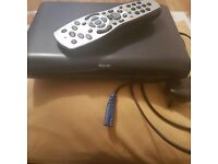 Sky HD box with plug and remote control