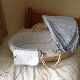 Baby's Moses basket, stand and matching blanket