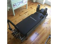 Pilates rowing machine with accessories