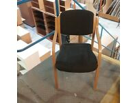 Wooden chair with padded cushion in grey