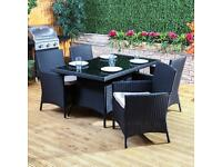 Black rattan effect garden furniture. Table and 6 chairs