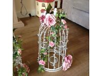 Bird cage and tea light holder with artificial flowers