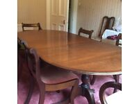 Antique dining table which extends and 6 dining chairs, 2 with arms