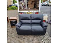 2 seater sofa in black fully reclining some sign of wear hence price £55