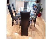 Extendable Glass Dining Table with 6 Black Leather Chairs