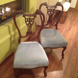 2 lovely low sky blue chairs with shaped wooded backs
