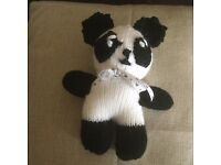 Knitted panda toy