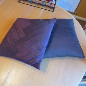 Two cushions - one deep purple, one brown