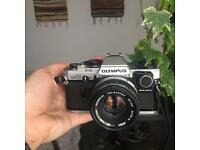 Olympus OM10 + 50 mm 1.8 + Manual Adapter. (Film 35mm Camera).