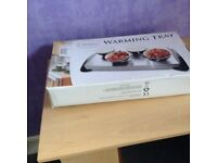 Warming tray still in box used only once