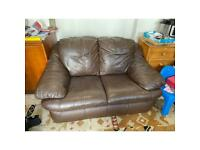 Brown leather effect sofa.