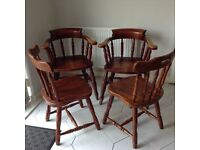 4 lovely heavy wooden chairs which 2 are captain style s on the chairs.asking price£150.