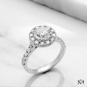 DIAMOND ENGAGEMENT RING WITH A .75 CARAT CENTER / BAGUE DE FIANCAILLE AVEC DIAMANT DE .75 CARAT