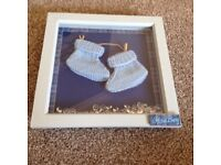 New born pictures with baby booties