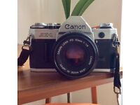 Canon AE-1 SLR Film Camera with assorted lenses and case