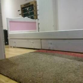 Girls single bed. Solid pine with storage draws underneath.