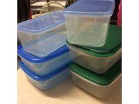 Six plastic storage boxes