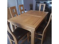 Extendable dining table, 6 chairs and cabinet for sale