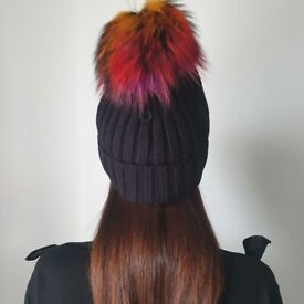 3 black hats with multi coloured fur on