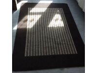 Large rubber backed striped floor rug / mat in browns. Nearly new condition. approx 190 X 133 cm
