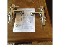 A pair of new ideal standard basin taps boxed
