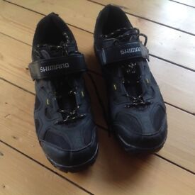 Men's black Shimano cycling shoes with cleats. Size 12 (48). Very little used.