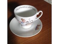 A novelty cup and saucer dish washer and microwave safe