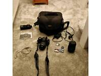 Olympus e410 DSLR with two lenses and flash gun