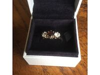 Ruby/garnett and Cz /mosenite . ring size n 9ct gold
