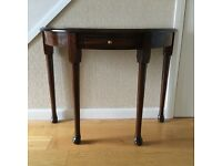 """Half moon mahogany table with drawer. Excellent condition. 30""""h x 39""""w x 18""""d."""