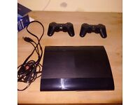 PS3 with 2 wireless controllers and games