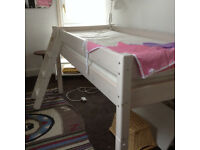 Solid Thuka mid sleeper bed with mattress, topper and anglepoise lamp.