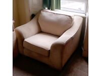 Large armchair grey and nearly new. Very comfortable.