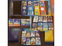 Original Walt Disney VHS tapes with the disney mickey mouse silver hologram badge
