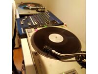 2 x Technics 1210 mkII with 8 channel Mixer