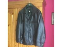 Leather coat , size large with a good lining .